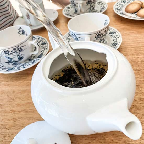Fill teapot with boiling water