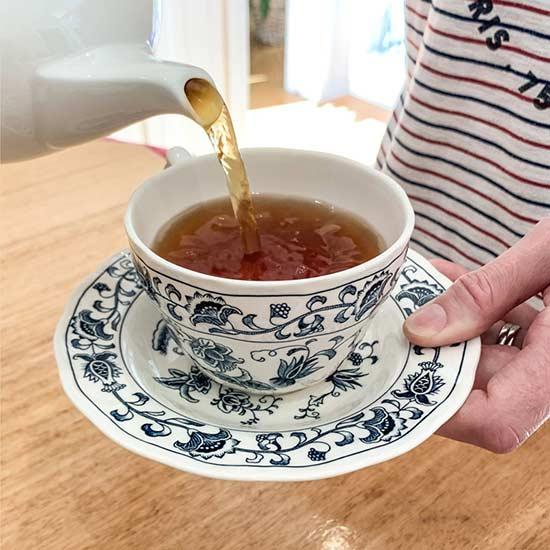 Pour tea into teacup
