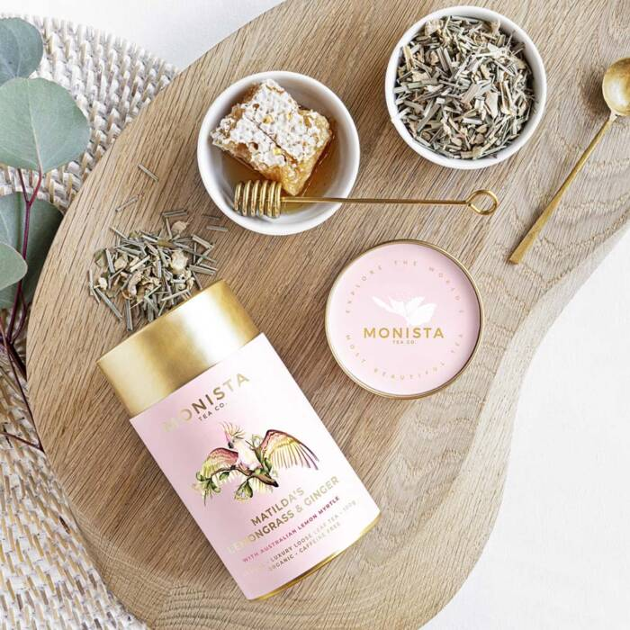 Matilda's Lemongrass and ginger pink tea canister with honey and spoon