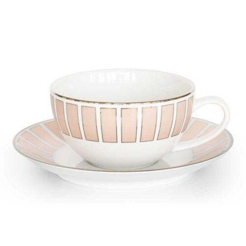 pink tea cup and saucer