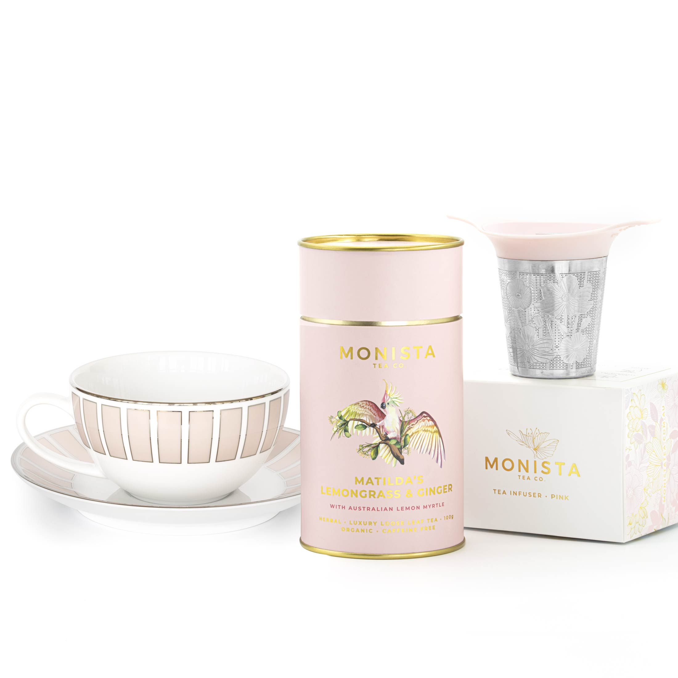 tea cup and saucer with matilda's lemongrass and ginger tea and infuser