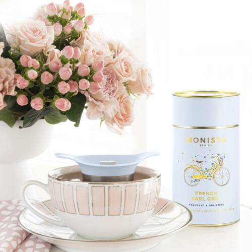 French Earl Grey tea with cup and saucer and infuser