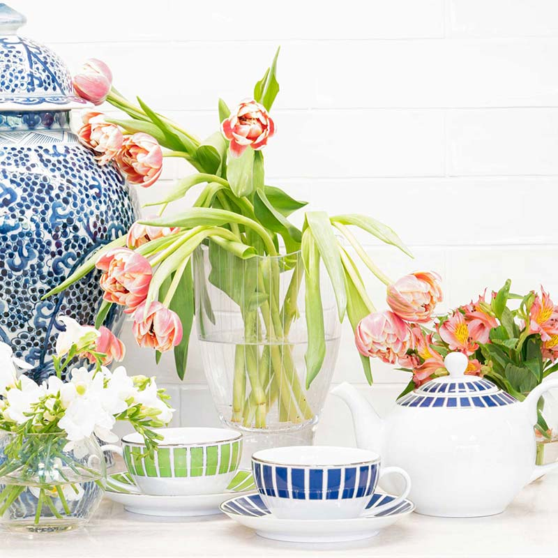 tea cup and saucer and kettle with flowers